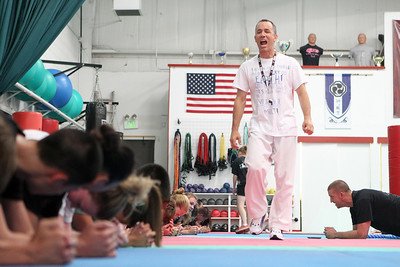 Mike Greene - mgreene@shawmedia.com Jim O'Hara, owner and sensei of Focus Martial Arts, instructs his students doing conditioning for the upcoming AAU Karate National Championships Saturday, June 30, 2012 in Lake in the Hills.