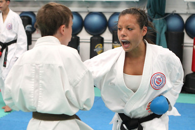 Mike Greene - mgreene@shawmedia.com Katie Gordon, 17 of Lake in the Hills, practices sparring with a partner while training for the upcoming AAU Karate National Championships Saturday, June 30, 2012 at Focus Martial Arts and Fitness in Lake in the Hills.