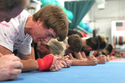 Mike Greene - mgreene@shawmedia.com Zack Ernst, of Carpentersville, and teammates do planks while training for the upcoming AAU Karate National Championships Saturday, June 30, 2012 at Focus Martial Arts and Fitness in Lake in the Hills.