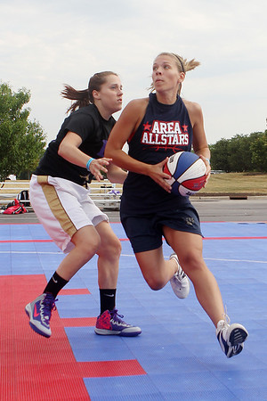 Mike Greene - mgreene@shawmedia.com Area All-Star's Katie Momola, of Marengo drives against a member of team Arete during the 2nd annual Gus Macker 3-on-3 Basketball Tournament at Marengo Community High School Saturday, June 30, 2012 in Marengo.