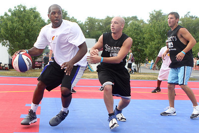 Mike Greene - mgreene@shawmedia.com Living Legend's Ken Riley drives against The Little Rascal's Rob Capozziello during the 2nd annual Gus Macker 3-on-3 Basketball Tournament at Marengo Community High School Saturday, June 30, 2012 in Marengo.