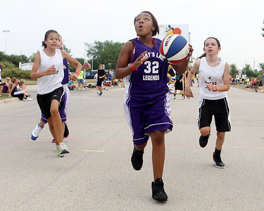 Mike Greene - mgreene@shawmedia.com The Hustlers' Victoria Malone, 13 of Rockford, drives toward the hoop against 4 Amigas during the 2nd annual Gus Macker 3-on-3 Basketball Tournament at Marengo Community High School Saturday, June 30, 2012 in Marengo.