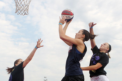 Mike Greene - mgreene@shawmedia.com Are All-Star's Taylor Koester, of McHenry, drives for a layup while playing against team Arete during the 2nd annual Gus Macker 3-on-3 Basketball Tournament at Marengo Community High School Saturday, June 30, 2012 in Marengo.