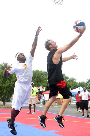 Mike Greene - mgreene@shawmedia.com The Little Rascal's Jordan Teegarden, of St. Charles, drives for a reverse layup while playing against Living Legends during the 2nd annual Gus Macker 3-on-3 Basketball Tournament at Marengo Community High School Saturday, June 30, 2012 in Marengo.