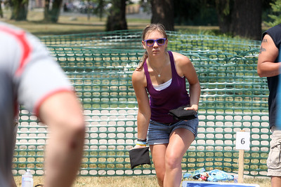 Mike Greene - mgreene@shawmedia.com Elizabeth Quinn, of Crystal Lake, competes in the Baggo Tournament during the 33rd annual Lakeside Festival Saturday, June 30, 2012 at the Lakeside Legacy Arts Park in Crystal Lake.