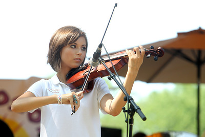 Mike Greene - mgreene@shawmedia.com Olivia Wigman, 17 of McHenry, performs with 4 Strings Attached during the 33rd annual Lakeside Festival Saturday, June 30, 2012 at the Lakeside Legacy Arts Park in Crystal Lake.