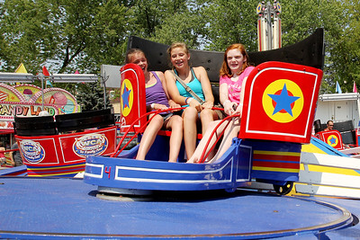 Mike Greene - mgreene@shawmedia.com Erica Thompson (left), 13 of Algonquin, Reilly Gnewuch, 14 of Cary, and Lexie Schyvinck, 13 of Johnsburg, ride the Tilt-A-Whirl during the 33rd annual Lakeside Festival Saturday, June 30, 2012 at the Lakeside Legacy Arts Park in Crystal Lake.