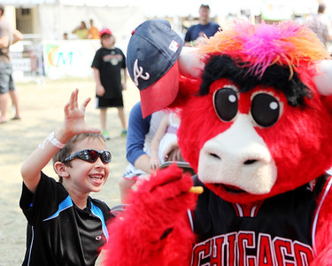 Mike Greene - mgreene@shawmedia.com Andrew Dovidio, 6 of Woodstock, tries to get his hat back after it was stolen by Benny the Bull during the 33rd annual Lakeside Festival Saturday, June 30, 2012 at the Lakeside Legacy Arts Park in Crystal Lake.