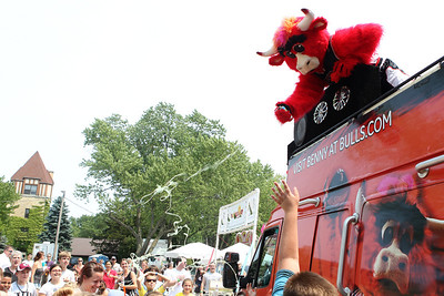 Mike Greene - mgreene@shawmedia.com Benny the Bull sprays silly string on the crowd surrounding his bus during the 33rd annual Lakeside Festival Saturday, June 30, 2012 at the Lakeside Legacy Arts Park in Crystal Lake.