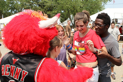 Mike Greene - mgreene@shawmedia.com Jordan Steiner (right) tries to coax his friend Keeley Peterson, both 15 of Crystal Lake, into giving Benny the Bull a hug during the 33rd annual Lakeside Festival Saturday, June 30, 2012 at the Lakeside Legacy Arts Park in Crystal Lake.