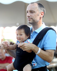 Mike Greene - mgreene@shawmedia.com Peter Worrall, of McHenry, dances with his daughter Amelia while listening to 4 Strings Attached perform during the 33rd annual Lakeside Festival Saturday, June 30, 2012 at the Lakeside Legacy Arts Park in Crystal Lake.
