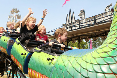 Mike Greene - mgreene@shawmedia.com James Martin (front), 3 of Crystal Lake, his brother Josh Martin, 6, and cousin Tessa Dvorsky, 2 of Cedar Rapids ride the Dragon Wagon during the 33rd annual Lakeside Festival Saturday, June 30, 2012 at the Lakeside Legacy Arts Park in Crystal Lake.