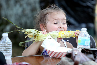 Mike Greene - mgreene@shawmedia.com Sofia Del Rio, 3 of Lake in the Hills, enjoys a corn on the cob during the 33rd annual Lakeside Festival Saturday, June 30, 2012 at the Lakeside Legacy Arts Park in Crystal Lake.