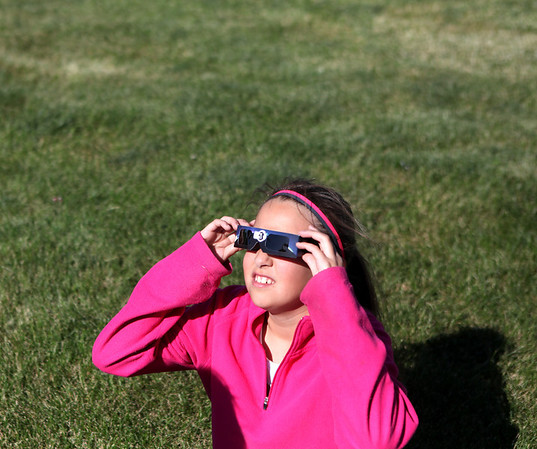 Nine-year-old Alicia Diaz tries to view the Venus transit across the sun as part of an astronomy night sponsored by the Kaneland High School science club Tuesday evening.