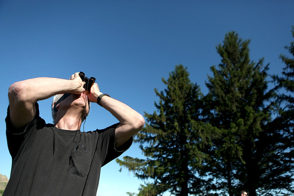 Rod Allen of St. Charles tries to view the Venus transit across the sun as part of an astronomy night sponsored by the Kaneland High School science club Tuesday evening.