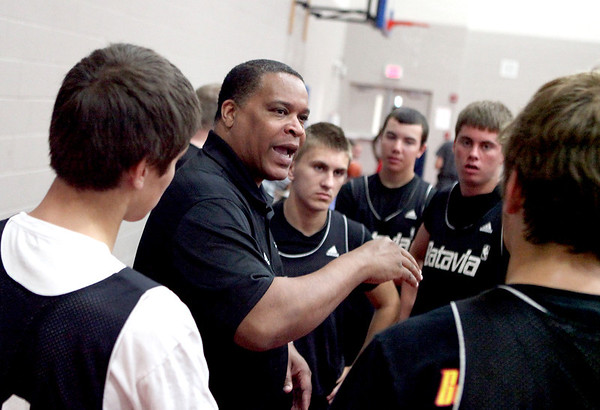 Anthony Williams coaches Batavia High School basketball players during half time of their 2012 Hoop Mountain Shootout game against South Elgin at West Aurora High School Friday. Longtime head coach Jim Roberts retired after last season.