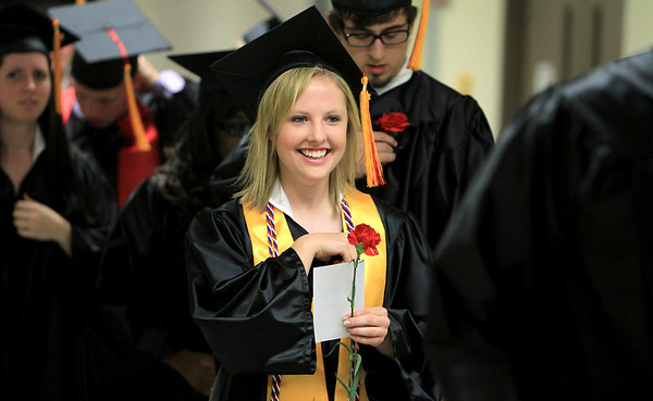 Batavia High School graduates proceed into the gymnasium during the school's commencement ceremony Friday night in Batavia.