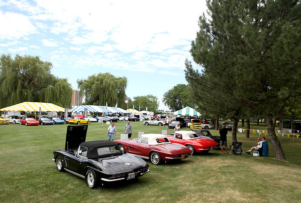 Patrons look at some of the Corvettes on display during the Bloomington Gold show at Pheasant Run Resort in St. Charles. The show runs through Sunday.