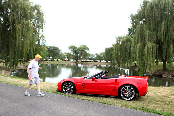 Steve Smith of Godfrey gets a closer look at a 2013 Chevrolet Corvette during the Bloomington Gold show at Pheasant Run Resort in St. Charles. The show runs through Sunday.
