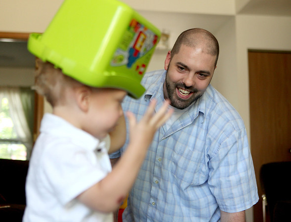 Joel Brens plays with his son, Jayden, in the living room of their Aurora home. Brens, originally from St. Charles, started Papas of Preemies, an online support group to help fathers with preemies cope. His son Jayden, now 2, was born premature.