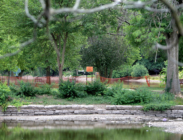 Barricades and signs mark the closure of the Fox River Trail connection to Island Park in Geneva.