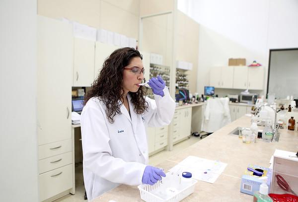 Flavorist Laura Partida of Aurora tastes  a peanut type flavor in her lab at FONA International in Geneva.