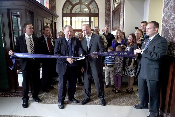 Batavia Mayor Jeff Schielke (center left) and Kurt Hagemann (center right) cut the ribbon to officially open Hagemann Wealth Management, located at 106 W. Wilson St. in Batavia.