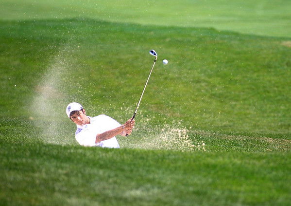 Raghav Cherala hits out of a bunker on the 12th hole during the IJGA Illinois State Junior Amateur tournament at Makray Memorial Golf Club in Barrington Wednesday.