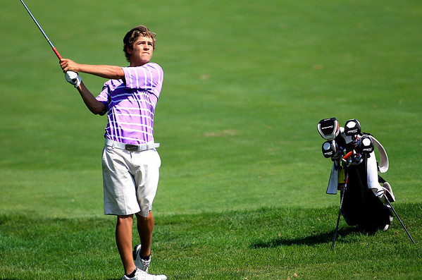 Grant Heelan hits from the 10th green during the IJGA Illinois State Junior Amateur tournament at Makray Memorial Golf Club in Barrington Wednesday.