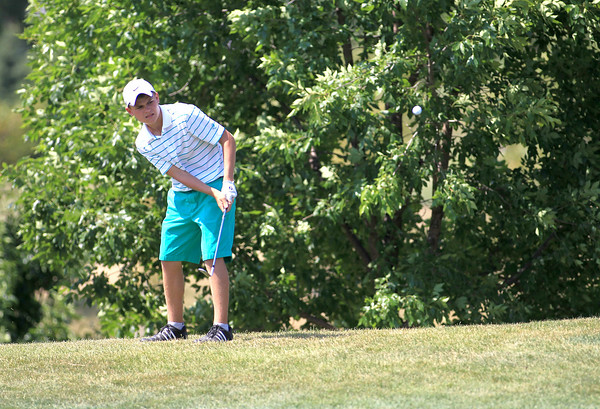 Trent Craig hits from the 16th green during the IJGA Illinois State Junior Amateur tournament at Makray Memorial Golf Club in Barrington Wednesday.