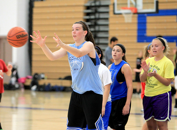 St. Charles North's Liz McNally practices during a morning basketball camp at the school Monday.