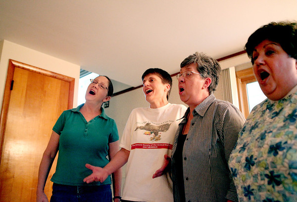 (Left to right) Linda Berg of Geneva, Maria Kolano of St. Charles, Beth Pasek of Elgin and Fran Bell of Aurora rehearse their four part harmony at Berg's home. The four make up the Misty River Music Makers a capella chorus.