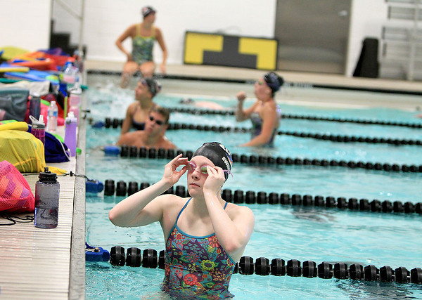 St. Charles North swimmer Meagan Popp checks the clock during a workout at St. Charles East Monday morning. Popp, along with St. Charles East graduate Emma Smith, will be competing in the U.S. Olympic Trials in Omaha next week.