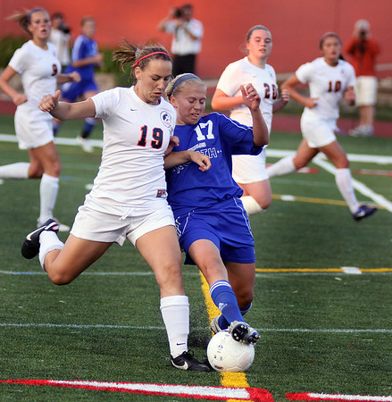 Jeff Krage – For the Kane County Chronicle<br /> St. Charles North's Kelly Manski battles for the ball with Naperville North's Brittany Weizeorick during Saturday's IHSA class 3A state championship at North Central College. The Northstars lost 1-0 in four overtimes.<br /> Naperville 6/2/12