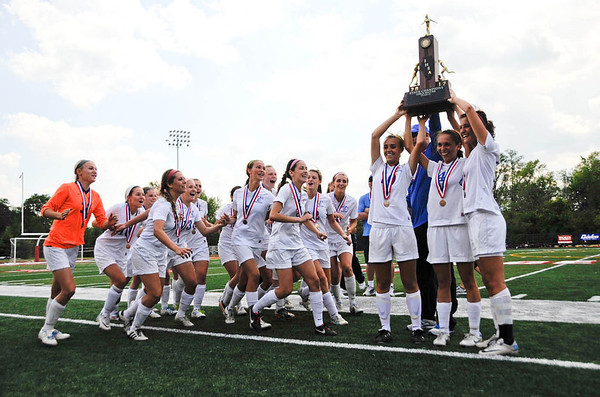 The St. Francis girls soccer team celebrate after receiving their trophy for beating Chatham Glenwood 2-1 during the class 2A State Finals at North Central College in Naperville Saturday afternoon.