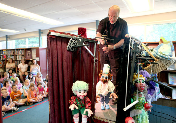 Dave Herzog performs with his marionettes to a captive audience during a kick-off of the Elburn Town and Country Public Library's summer reading program Monday night.