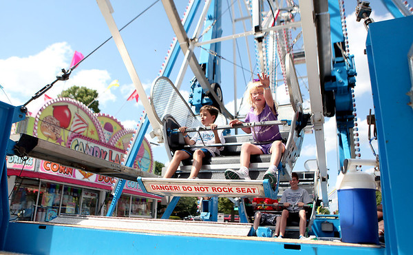 Jack Coomans, 9, of West Chicago and Lily Pierini, 7, of Geneva ride the ferris wheel during the opening day of Swedish Days in downtown Geneva Tuesday.