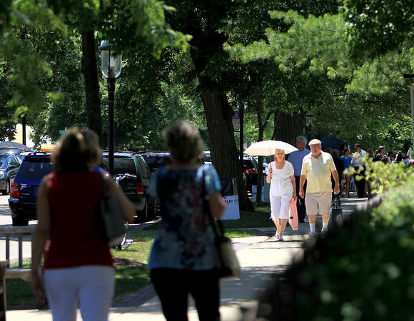 Shoppers walk down Third Street during Swedish Days Wednesday.