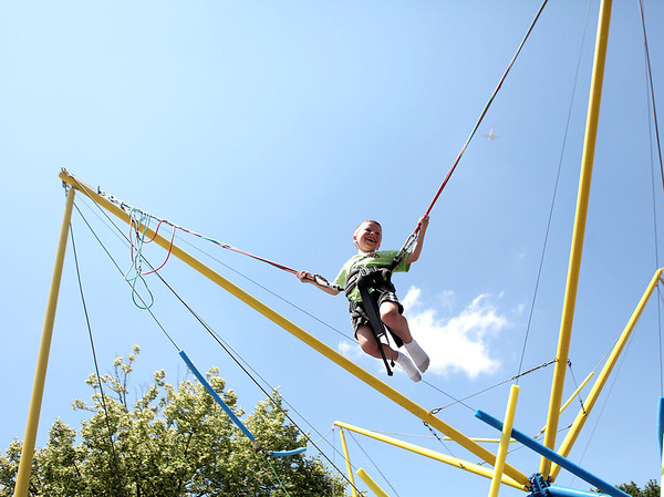 Five-year-old Henry Blackmore plays on the Quad Power Jump during Swedish Days Wednesday.
