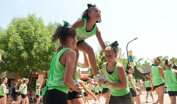 The Allstar Rebels Competitive Cheerleading team participates in the Swedish Days Parade in Geneva Sunday afternoon.