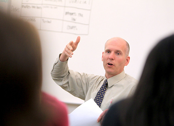 St. Charles East teacher Andrew Johnson teaches a government class to incoming seniors during summer school Thursday morning. The class meets five hours per day for three weeks.