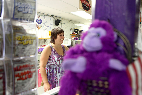 Pat Hill, owner of Hill's Country Store (The Purple Store) in Kaneville, helps a customer at the store last week.