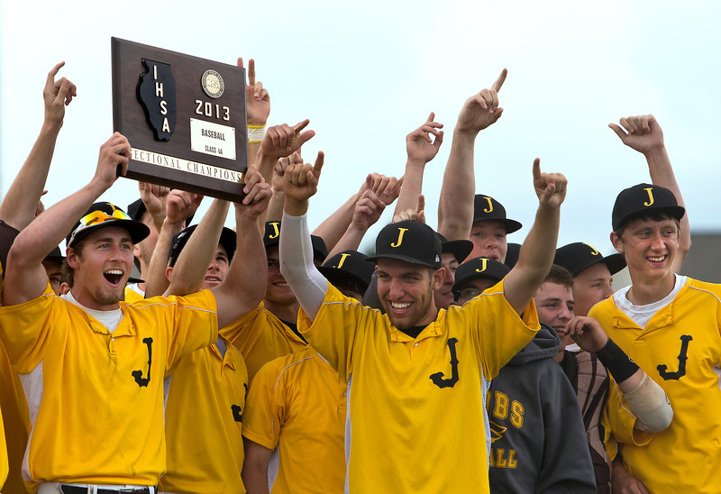 Brett Moist/ for the Northwest Herald Jacob's players celebrate their class 4A Sectional Championship after defeating Dundee Crown 9-0 at Huntley High School on Saturday.