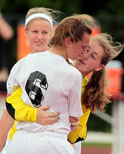 H. Rick Bamman - hbamman@shawmedia.com Prairie Ridge goal keeper Brook Laibly consoles teammate Hallie Simons after the Wolves' loss to Glenwood.