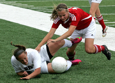 H. Rick Bamman - hbamman@shawmedia.com Prairie Ridge's Erin Ginsberg (20) and Glenwood's Laura Hunt fall to the  ground while chasing the ball in the second half in the Class 2A State Soccer championship match Saturday, June 1, 2013. Prairie Ridge placed second after falling to  Glenwood 4-1.