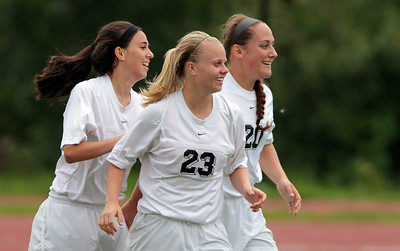 H. Rick Bamman - hbamman@shawmedia.com From left Shannon Patinella, Becca Hoklas and Erin Ginsberg celebrate Patinella's goal in the first half.