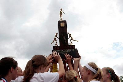 H. Rick Bamman - hbamman@shawmedia.com The second place trouphy is lifted by members of the Prairie Ridge soccer team.
