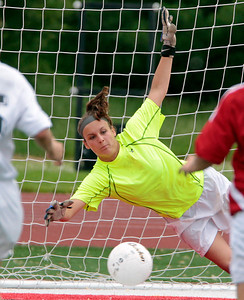 H. Rick Bamman - hbamman@shawmedia.com Prairie Ridge goalie Whitney Whitehouse tries to stop a second half goal by  Glenwood's Kelly Graves in the second half in the Class 2A State Soccer championship match Saturday, June 1, 2013. Prairie Ridge placed second after falling to Glenwood 4-1.