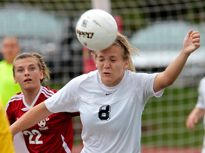 H. Rick Bamman - hbamman@shawmedia.com Prairie Ridge's Jordyn Reitz heads the ball in front of Glenwood's Maggie Juhlin in the first half of the Class 2A State Soccer championship match Saturday, June 1, 2013.