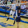 St. Charles North's Johnathan Orech (2) plays the ball over the net against Oak Park-River Forest's Levi Algozino (10)<br /> during their state quarterfinal game at Hoffman Estates High School in Hoffman Estates, IL on Friday, May 31, 2013 (Sean King for The Kane County Chronicle)